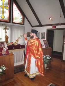 Priest censes at Greenville, NC Greek Orthodox Church